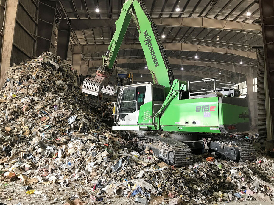 SENNEBOGEN 818 E material handler during recycling handling work in the USA
