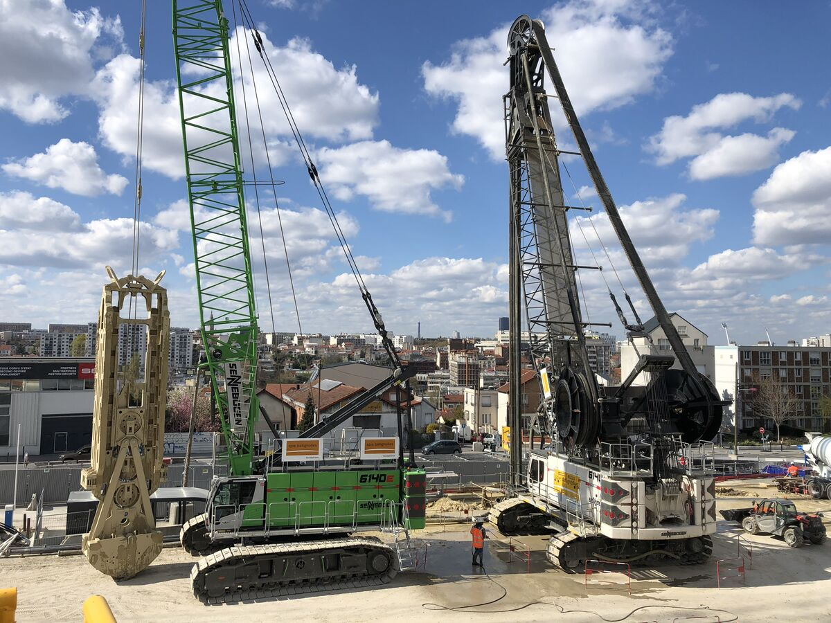SENNEBOGEN 6140 HD rope excavator and 7700 R-SL crawler crane used in building construction / civil engineering for Grand Paris Express in France