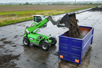 SENNEBOGEN telehandler 355 E loading of compost in container composting plant elevating cab shovel